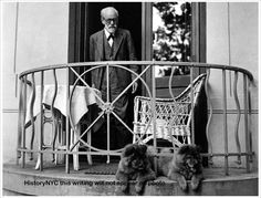 1935. Sigmund Freud on the balcony with his chow dogs.