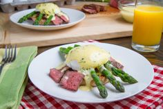 Steak and Eggs Benedict with Asparagus in Bearnaise Sauce. Great idea for left over steak.