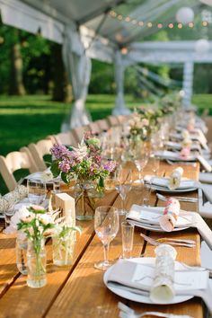 family style tablescape, photo by The More We See http://ruffledblog.com/philadelphia-estate-wedding #weddingreception #tables