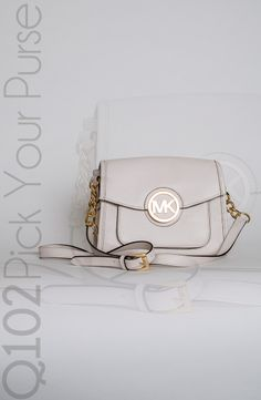 Michael Kors - Margo Messenger in Vanilla. Go to wkrq.com to find out how to play Q102's Pick Your Purse!