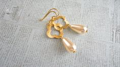 Brushed Clover Gold Filled And Vanilla Glass by daydreamjewels,