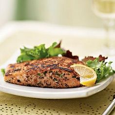 Herb-Crusted Salmon with Mixed Greens Salad - Chopped fresh herbs dress up salmon fillets, which are a great source of heart-healthy omega-3 fatty acids. The homemade vinaigrette brightens salad greens while keeping calories and fat in check. Serve salmon with lemon wedges..  Print this recipe at AmericanFamily.com.