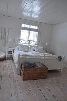 I like the idea of using an old wooden box for blanket storage at the foot of the bed