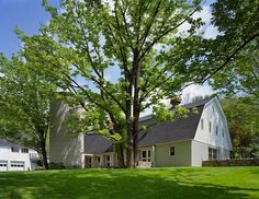 An elegant, modern home within a reconstructed dairy barn situated in Wilton, Connecticut. The project was designed by New York – based architects from Specht Harpman.