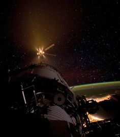 THRUST A FRIEND A photograph by NASA astronaut Don Pettitt offers a previously unseen view of the SpaceX Dragon spacecraft as it approached the International Space Station last week. (Photo: NASA via The Telegraph)