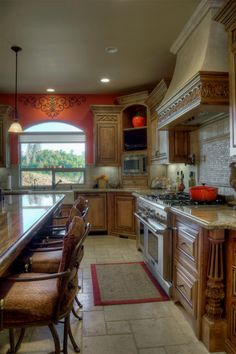 TUSCAN KITCHEN, This Tuscan kitchen and dining space features alder wood cabintry, beautiful granite counter tops, and a bold yet sophistica...