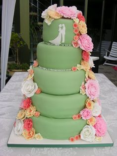 pretty green wedding cake with a white silhouette