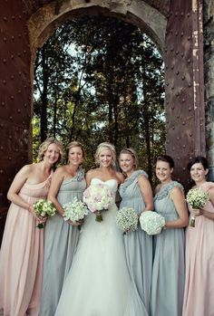 gray and pink wedding and each girl has a different bouquet