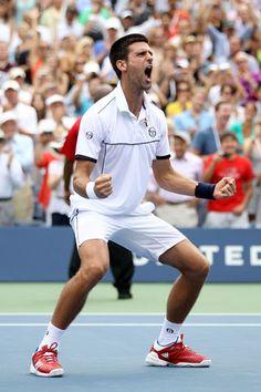 Novak Djokovic celebrates after defeating Roger Federer during Men's Semifinals.  September 2011.  #tennis