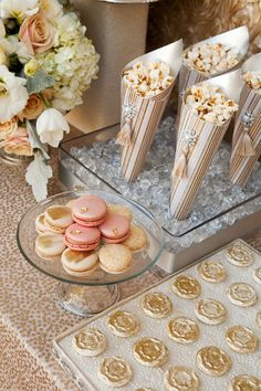 make paper cones out of gold and blush paper and add silk ivory mini flower with pearl in it and make DIY caramel popcorn for dessert table