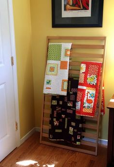 Side of an old crib, as a blanket rack. (Would also make a good magazine rack.) This is particularly genius now that you can't sell/donate drop-side cribs. Gotta use them for something, right?