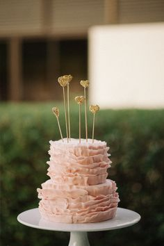 Ruffly pink cake with gold heart toppers.  Had this made for our pink and gold party......unbelievably beautiful!