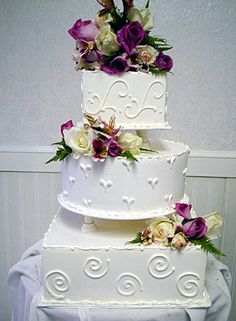 white embossed Cake with purple flower accents