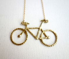 Love this! Would be really cool in rose gold too. Brass Bike Necklace