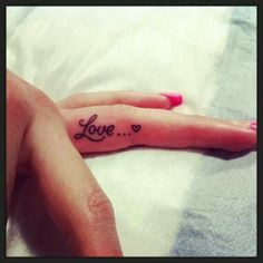 Love finger tattoo