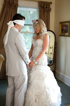 praying together before the wedding while he's blindfolded...LOVE THIS!!!!!