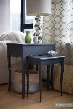 I like the silver with the pattern on the curtains... even the dark blue side tables... great idea