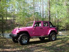 hot pink 4 Door jeep wrangler with 3 inch lift.... yes please!