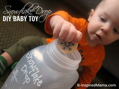 What are your favorite games to play with baby?  Check out this simple DIY Snowflake Drop Baby Activity from B-InspiredMama.com.