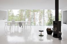 A classic use of the Rais wood fireplace in it's perfect home: modern, clean, simple. Fits right in.