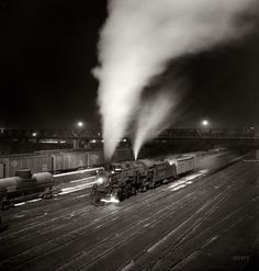 "March 1943. Argentine, Kansas. ""Freight train about to leave the Atchison, Topeka & Santa Fe Railroad yard for the West Coast."" Medium-format nitrate negative by Jack Delano for the Office of War Information. View full size."