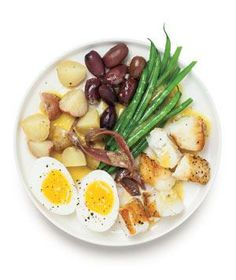 Warm Bass Niçoise Salad recipe: You can make everything but the fish up to 2 days in advance, then cook the fish just before serving.