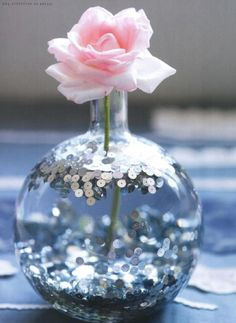sequins in a vase with water. Obsessed.