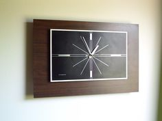 Large Mid Century Modern Wall Clock General Electric. $55.00, via Etsy.