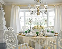 Trellis-style chairs with raffia-covered seats complement a garden-inspired tablescape in the dining room