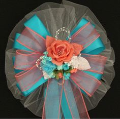 Coral and Turquoise Pew Bows. So excited to have these. Matches our color scheme perfectly. They are gorgeous!