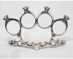 Diamond ring brass knuckles