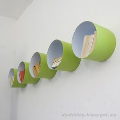 large cans on the wall as shelves.