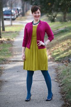 Already Pretty outfit featuring magenta cardigan, lime green jersey dress, teal tights, chrysocolla necklace, navy pumps