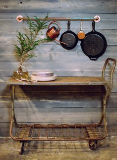 Copper pot rack. love the iron skillets