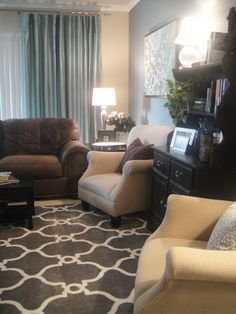 """This small living room by A Well Dressed Home is awesome! Modern, fresh, but homey - definitely the """"feel"""" I am looking for. Plus I love those mirrors and that rug!"""