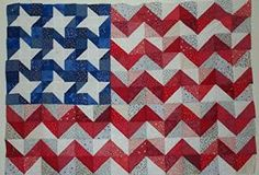 Free flag quilt pattern... (I have had this quilt hanging in my house for over 15 years and have made several as gifts.  Nice to see it out there.  Trisha)