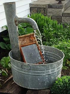 A Red Hand Pump Combined With A Washboard And Laundry Tub