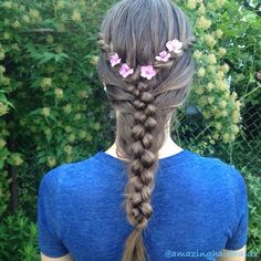 Summer braid with rose flowers
