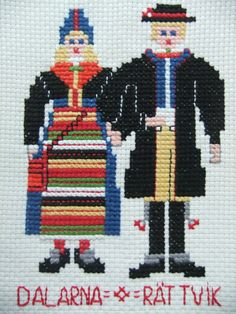 Vintage Swedish embroidered wall hanging with couple in costumes Dalarna-Rättvik. $11.40, via Etsy.