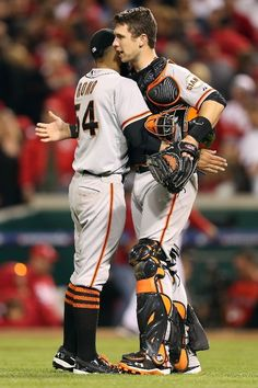 Sergio Romo #54 and catcher Buster Posey #28 of the San Francisco Giants celebrate after the Giants defeat the Cincinnati Reds 2-1 in the 10th inning in Game Three of the National League Division Series at the Great American Ball Park on October 9, 2012 in Cincinnati, Ohio. Romo earned the win in the victory.