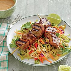 Beef Kabobs with Broccoli Slaw and Peanut Sauce | We tested with tri-tip and rib-eye steak, but use your favorite cut.