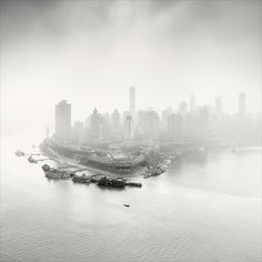 City of Fog is a series of photographs from Chongqing, China - also known as City of Fog. These beautiful photos are taken by Martin Stavars, born in 1981 in Czestochowa, Poland.
