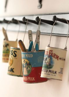 Hanging cans with reproduction vintage labels corral tools, office supplies, or kitchen utensils.