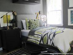 Teen Boy Bedroom ideas... Mined Coal paint (Behr), mixed metals, glen plaid headboard, tree stump side table, weathered wood mirror, tweed valence, IKEA Besta cabinets and nightstands,Ribba frames, & Mellby chair
