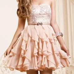 white top and skin color bottom with a bow:) love this skirt if it was a bit longer and had either a bolero or sleeves.