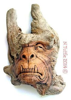 """Coastal Carnivore""   This grotesquely gorgeous gargoyle measures 10 inches  tall and approximately 6¼ inches across his widest point.  He's carved from a driftwood Douglas Fir tree root.   Signed and dated:  N. Tuttle 3/19/14"
