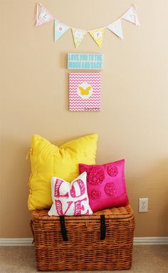 Add a pop of color to your nursery will bright pillows. #pillows
