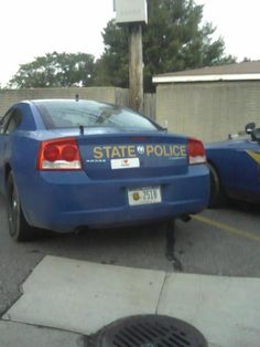 """Saw this bumper sticker on a State Police car parked in Tim Horton's. The sticker reads """"I (heart) porn."""""""