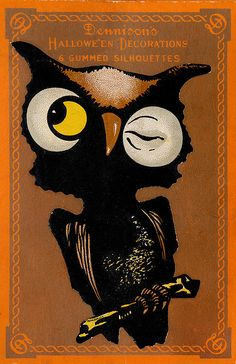 Package of vintage Halloween decorations featuring a winking owl on the front