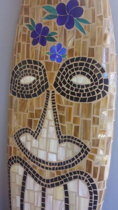TIKI Glass Mosaic Surfboard.   Awesome detail!  Seen these in person.  Michelle does a great job!